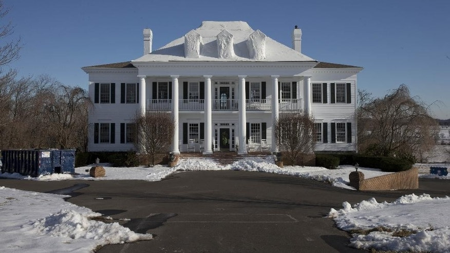 "FILE - In this Wednesday, Feb. 11, 2015 photo shows the mansion called ""Clairemont,"" in New Hope, Pa.   The family whose mansion burned three times in five years heads to court for a hearing to determine if they'll face trial in a $20 million insurance fraud case. The state attorney general's office has accused political fundraiser and hostess Claire Risoldi and her family of living large on trumped-up insurance claims. A grand jury report says the home in suburban Philadelphia has had three suspicious fires in five years. (AP Photo/Matt Rourke)"