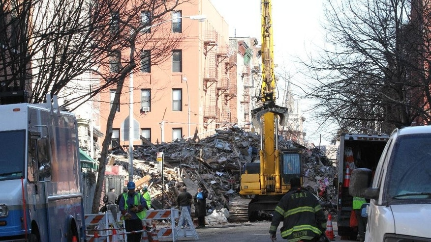 A pile of rubble is seen Sunday, March 29, 2015, at the site of an apparent gas explosion that took place three days earlier in the East Village neighborhood of New York. (AP Photo/Tina Fineberg)