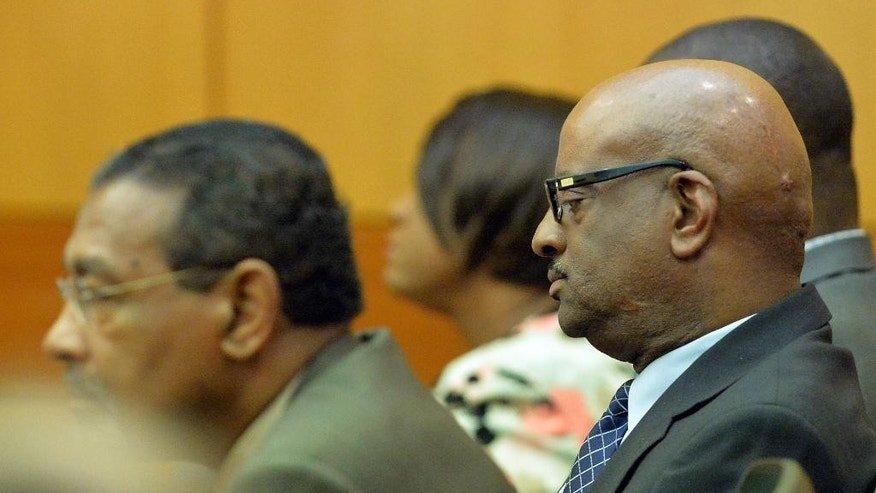 Former Atlanta Public Schools school research team director Michael Pitts, right, listens as a jury found hims guilty in the Atlanta Public Schools test-cheating trial, Wednesday, April 1, 2015, in Atlanta. Pitts and 10 other former Atlanta Public Schools educators accused of participating in a test cheating conspiracy that drew nationwide attention were convicted Wednesday of racketeering charges. (AP Photo/Atlanta Journal-Constitution, Kent D. Johnson, Pool)