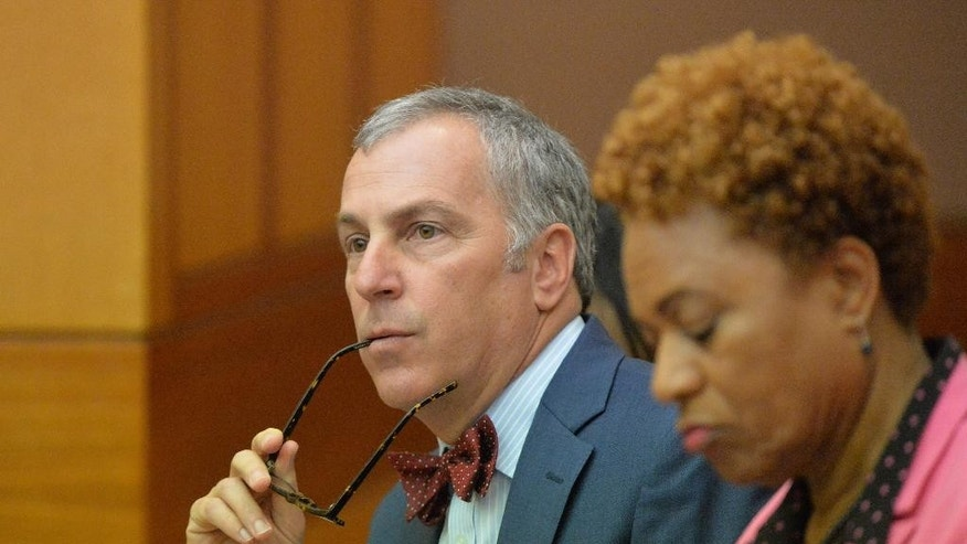 Defense attorney Robert Rubin, left, and former Former Atlanta Public Schools school research team director Sharon Davis Williams, listen as the verdicts are read in the Atlanta Public Schools test-cheating trial, Wednesday, April 1, 2015, in Atlanta. Williams and 10 other former Atlanta Public Schools educators accused of participating in a test cheating conspiracy that drew nationwide attention were convicted Wednesday of racketeering charges. (AP Photo/Atlanta Journal-Constitution, Kent D. Johnson, Pool)