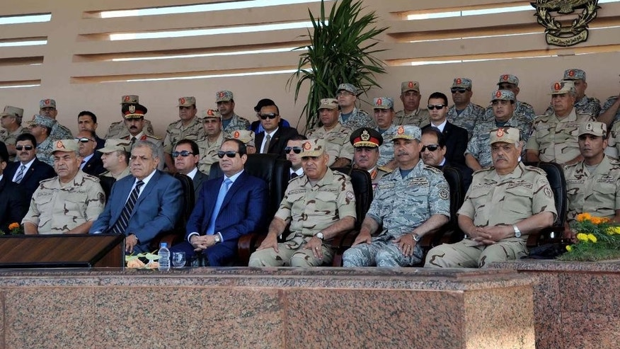 FILE - In this Monday, Nov. 3, 2014 image released by the Egyptian Presidency, Egyptian President Abdel-Fattah el-Sissi, center, watches an Air Force exercise as part of Badr 2014 Strategic Maneuver, in the Nile Delta province of al-Sharqia, Egypt. President Barack Obama on Tuesday, March 31, 2015 released military aid to Egypt that was suspended after the 2013 overthrow of the government, in an effort to boost Cairo's ability to combat the extremist threat in the region. (AP Photo/Sherif Abd El Minoem, Egyptian Presidency, File)