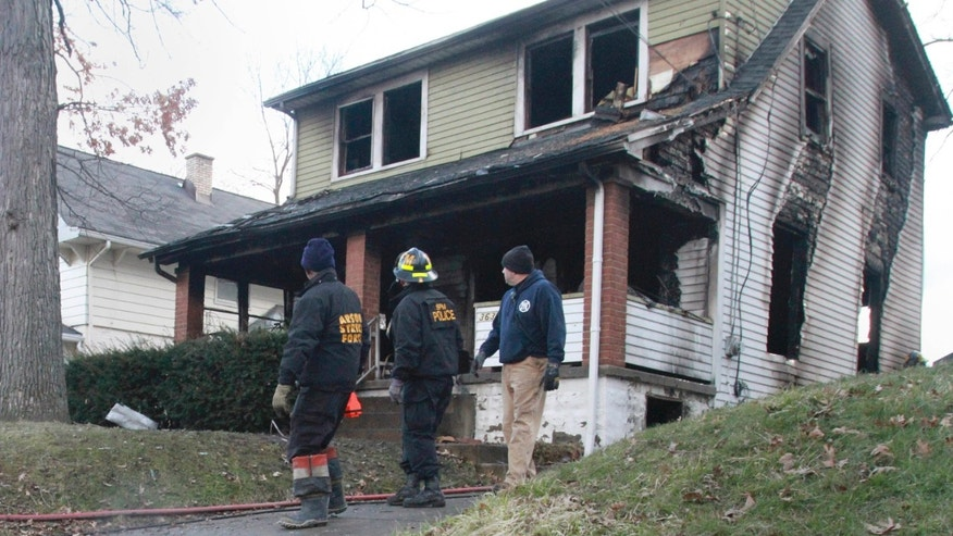March 30, 2015: Fire personal investigate an early house fire in Youngstown, Ohio. Autopsies are scheduled for three people who died in the house fire, including a 10-year-old girl who prosecutors say was connected to a rape trial set to begin later that day.