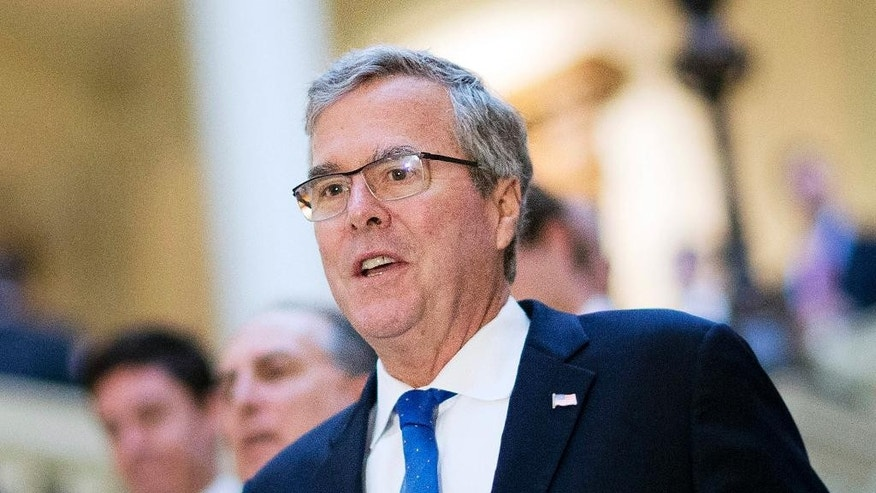 "FILE - In this March 19, 2015 file photo, former Florida Gov. Jeb Bush visits the Georgia Capitol in Atlanta. Republicans hoped to avoid a debate over social issues heading into the next presidential contest. Yet the backlash over a so-called religious freedom law in Indiana is highlighting the party's overwhelming opposition to same-sex marriage and forcing the GOP's leading presidential contenders to weigh in. ""I think Gov. Pence has done the right thing,"" former Florida Gov. Jeb Bush said in a March 30, radio interview. He said the law was ""simply allowing people of faith space to be able to express their beliefs."" (AP Photo/David Goldman, File)"
