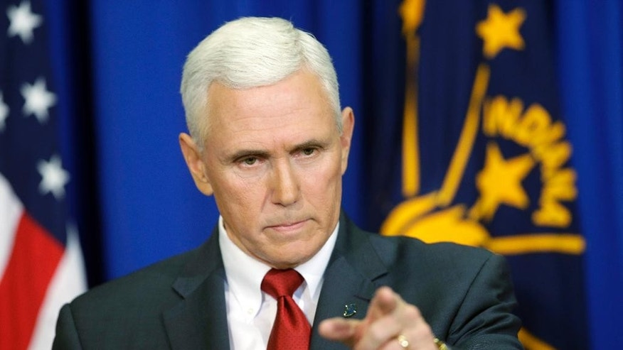 "Indiana Gov. Mike Pence takes a question during a news conference, Tuesday, March 31, 2015, in Indianapolis. Republicans hoped to avoid a debate over social issues heading into the next presidential contest. Yet the backlash over a so-called religious freedom law in Indiana is highlighting the party's overwhelming opposition to same-sex marriage and forcing the GOP's leading presidential contenders to weigh in. ""It's been a tough week,"" Pence said at the news conference. (AP Photo/Darron Cummings)"