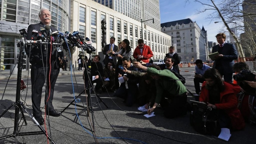 Thomas Dunn, left, attorney for Asia Siddiqui, speaks to members of the media outside Federal court Thursday, April 2, 2015, in the Brooklyn borough of  New York. Two women were arrested Thursday on charges they plotted to wage violent jihad by building a homemade bomb and using it for a Boston Marathon-type terror attack. (AP Photo/Mary Altaffer)