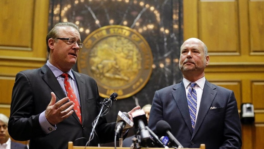 Indiana Senate President Pro Tem David Long, left, (R-Fort Wayne) and House Speaker Brian C. Bosma (R-Indianapolis) announce changes to the state's new religious objections law during a press conference in the House chamber at the Statehouse in Indianapolis, Thursday, April 2, 2015.  The measure has faced criticism it could allow discrimination against lesbians and gays. (AP Photo/Michael Conroy)