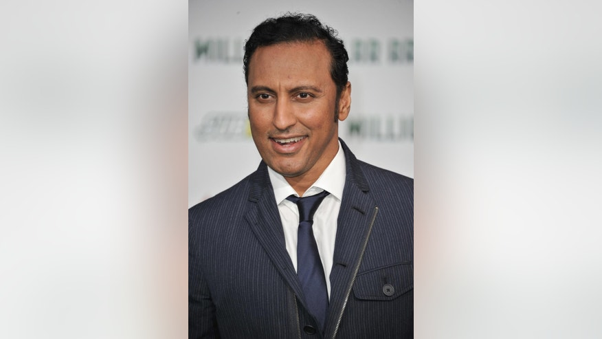 "FILE - In this May 6, 2014 file photo, Aasif Mandvi arrives at the world premiere of ""Million Dollar Arm,"" in Los Angeles. ""The Daily Show"" correspondent Mandvi's sitcom parody targeting anti-Muslim bias will debut on the ""Funny or Die"" website April 9, 2015. (Photo by Richard Shotwell/Invision/AP, File)"