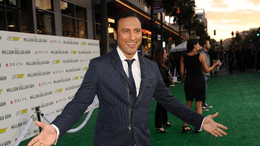 "In this May 6, 2014 file photo, Aasif Mandvi arrives at the world premiere of ""Million Dollar Arm"" at El Capitan Theatre, in Los Angeles. ""The Daily Show"" correspondent Mandvi's sitcom parody targeting anti-Muslim bias will debut on the ""Funny or Die"" website April 9, 2015. (Photo by Chris Pizzello/Invision/AP, File)"