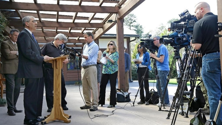 Michael Schoenfeld, left, vice president for Public Affairs and Government Relations at Duke University, speaks to members of the media during a news conference at the Sara P. Duke Gardens in Durham, N.C., Thursday, April 2, 2015. An undergraduate student at Duke University has admitted to hanging a noose in a tree and is no longer on campus, university officials said Thursday. Schoenfeld said that the school would not release the name of the student who admitted to hanging the noose. (AP Photo/Gerry Broome)