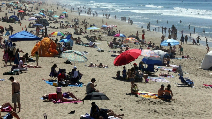 March 14, 2015: Crowds line the shore at Manhattan Beach, Calif., as a late winter heat wave sent temperatures soaring in Southern California.