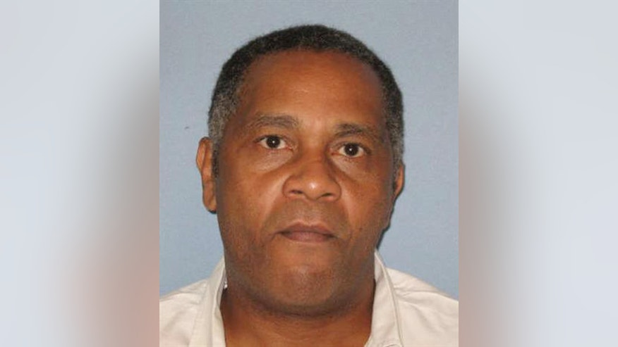 In this undated photo made available by the Alabama Department of Corrections, shows inmate Anthony Ray Hinton. Hinton, who spent nearly 30 years on death row will go free Friday, April 3, 2015,  after prosecutors told a court that there is not enough evidence to link him to the 1985 murders he was convicted of committing. (AP Photo/Alabama Dept. of Corrections)