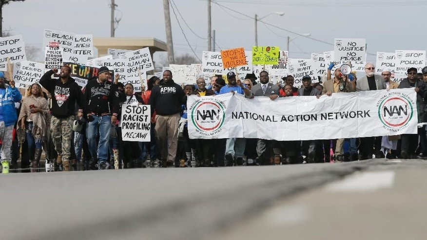Hundreds of protesters march on Michigan Ave in support of Floyd Dent on Friday, April 3, 2015 in Inkster, Mich. Dent, a black motorist, was pulled from his car in January, repeatedly punched in the head by a white police officer and subdued with a stun gun in suburban Detroit.  (AP Photo/Carlos Osorio)