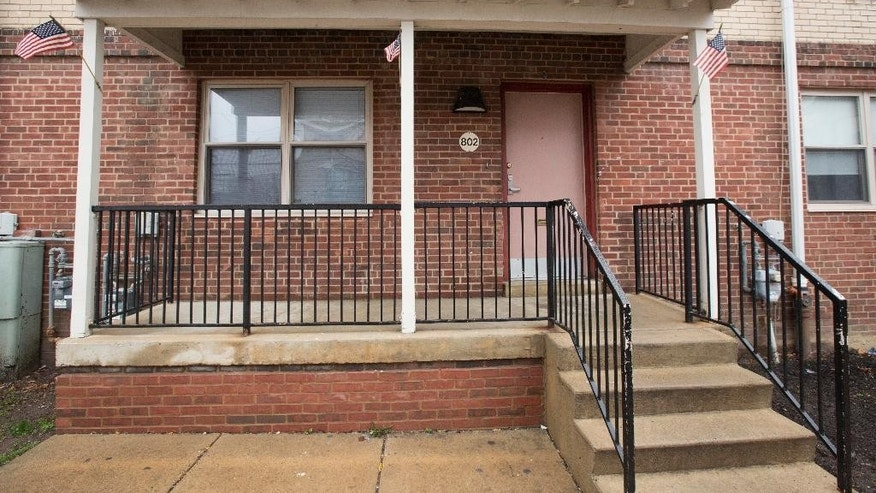 Shown is the home of a woman who is accused of trying to join and martyr herself for the Islamic State group in Syria, Friday, April 3, 2015, in Philadelphia. Thirty-year-old Keonna Thomas appeared in federal court Friday afternoon just hours after her arrest on a charge of attempting to provide material support and resources to a foreign terrorist organization. A prosecutor says a search warrant executed March 27 at Thomas' home prevented her from leaving the U.S. on a flight scheduled for March 29.(AP Photo/Matt Rourke)