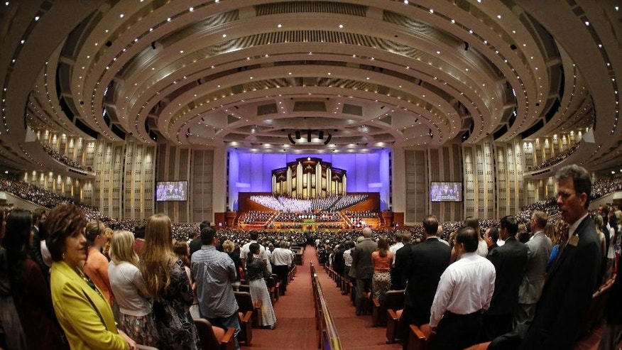 People attend the opening session of the Mormon church conference Saturday, April 4, 2015, in Salt Lake City. More than 100,000 people will file in and out of the church's conference center over five sessions Saturday and Sunday. (AP Photo/Rick Bowmer)