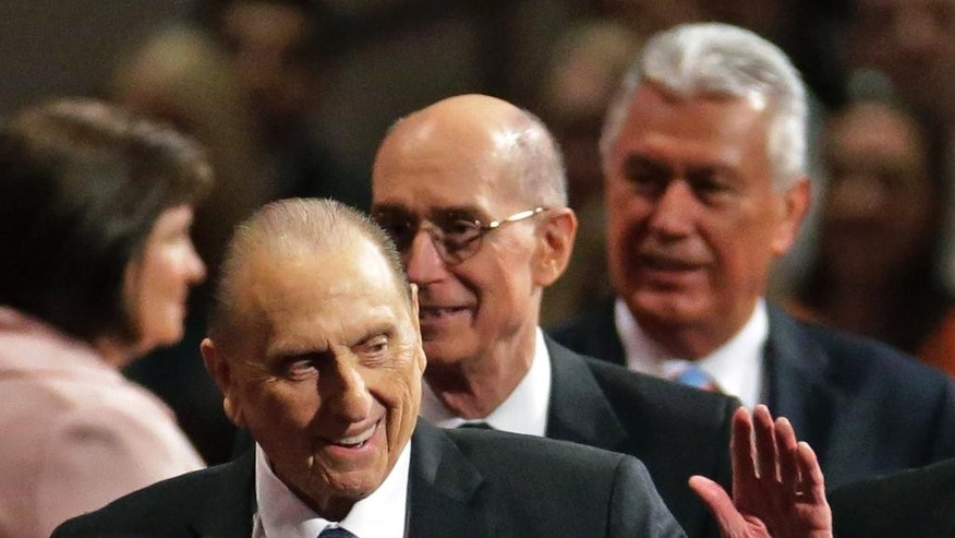 President Thomas S. Monson, of The Church of Jesus Christ of Latter-day Saints, waves to the audience during the opening session of the Mormon church conference Saturday, April 4, 2015, in Salt Lake City. More than 100,000 people will file in and out of the church's conference center over five sessions Saturday and Sunday. (AP Photo/Rick Bowmer)