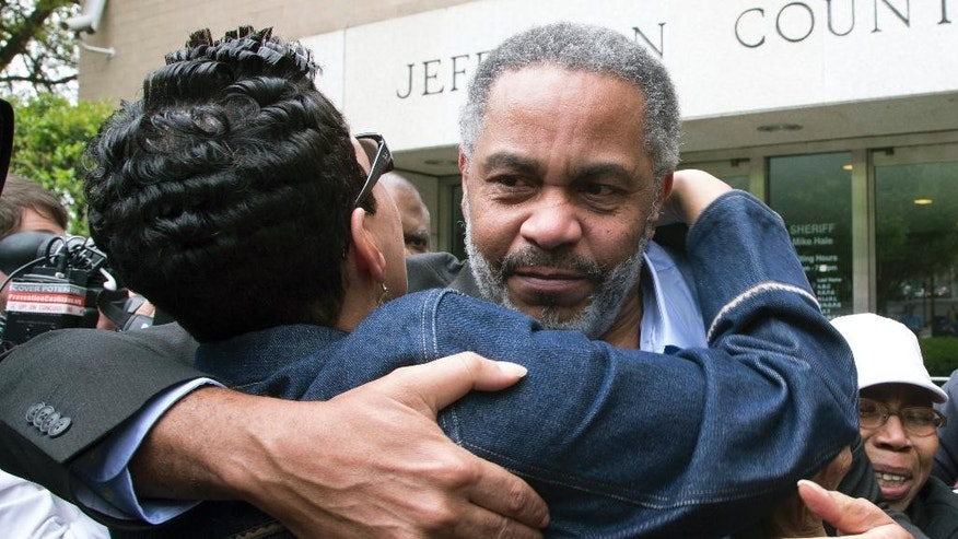 Pat Turner, left, hugs Anthony Ray Hinton as he leaves the Jefferson County jail, Friday, April 3, 2015, in Birmingham, Ala. Hinton spent nearly 30 years on Alabama's death row, and was set free Friday after prosecutors told a judge they won't re-try him for the 1985 slayings of two fast-food managers. (AP Photo/Hal Yeager)