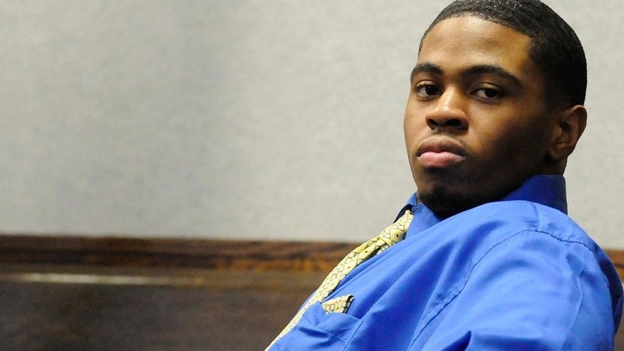 FILE - In this photo taken Feb. 27, 2015, Kamron T. Taylor, sits in a Kankakee County courtroom in Kankakee, Ill., after being convicted of murder.  Police in Chicago have arrested Taylor, a convicted murderer who escaped from an eastern Illinois jail and spent nearly three days on the run. Chicago police officers arrested Taylor late Friday, April 3, 2015, night after a foot chase. Taylor was found with a handgun. (AP Photo/The Daily Journal, Mike Voss)