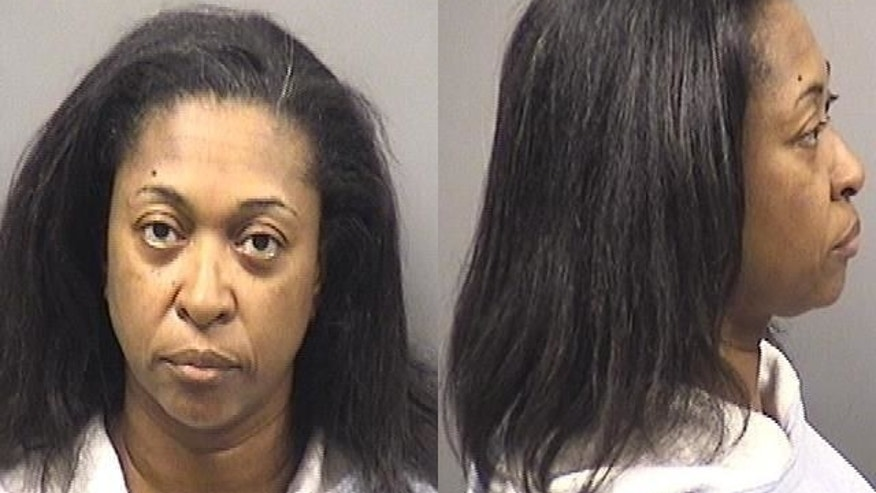 This photo provide by  Kankakee County Sheriff's Department shows Tonya Grant. Authorities have arrested Grant, the aunt of Kamron T. Taylor an eastern Illinois jail inmate,  on suspicion she helped aided his escape. Taylor, was captured Friday, April 3, 2015,  after a nearly three-day manhunt. He escaped from the Jerome Combs Detention Center in Kankakee, where his aunt used to work as a guard. (AP Photo/ Kankakee County Sheriff's Department)