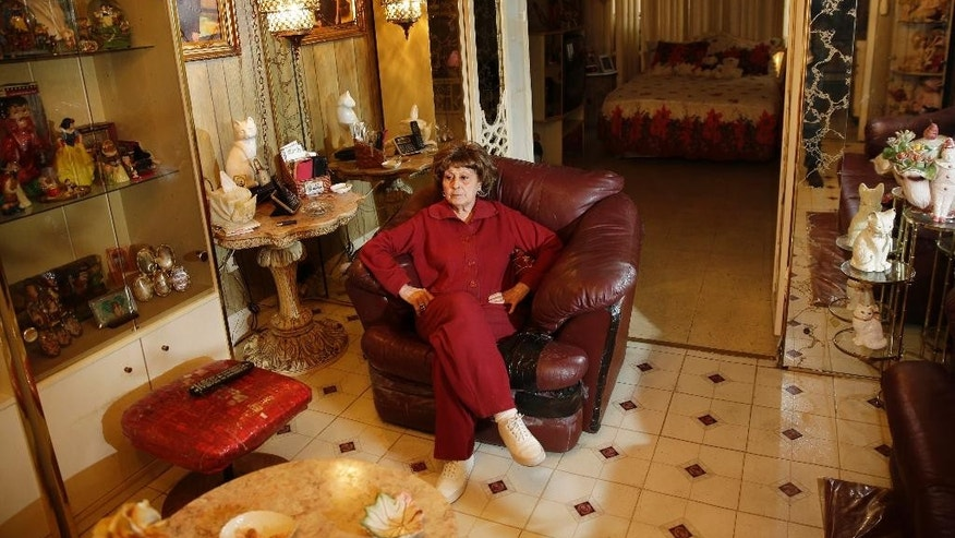 Adele Sarno poses for picture in her apartment in the Little Italy section of Manhattan, Tuesday, March 31, 2015, in New York.  A fight in Manhattan's Little Italy neighborhood between a landlord who wants a tenant out and a tenant who doesn't want to go isn't just the run-of-the-mill New York City real estate struggle. The landlord is a museum dedicated to the legacy of Italian Americans in the area. The tenant? Sarno, an 85-year-old Italian American woman, who's lived there for more than 50 years. (AP Photo/Seth Wenig)