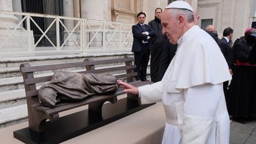 Pope Francis is presented 'Homeless Jesus' statue to Pope Francis at the Vatican last year.