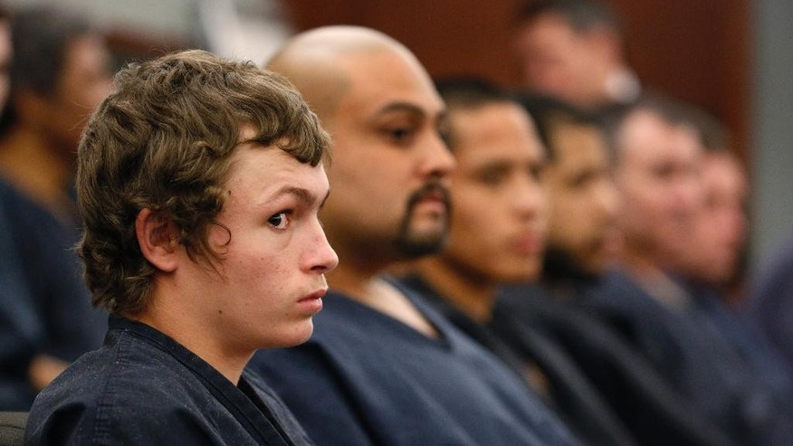 FILE - In this March 31, 2015, file photo, Erich Milton Nowsch Jr., left, appears in court in Las Vegas. Nowsch, 19, who is awaiting trial on murder and other charges in the shooting death of a Las Vegas mother of four is being hit with a separate felony charge alleging that he held a knife to the throat of a 13-year-old boy. Prosecutors filed a battery with a weapon charge Monday, April 6. (AP Photo/John Locher, File)