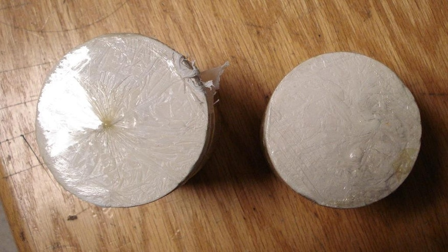 This April 1, 2015 photo provided by the U.S. Customs and Border Protection shows cylinders of heroin weighing approximately two pounds in the U.S. Customs and Border Protection office at John F. Kennedy International Airport in New York. CPB agents say they intercepted the heroin as Colombian citizen, Ivan Vidal Forero, tried to smuggle it into the country hidden in his underwear. (AP Photo/U.S. Customs and Border Protection)