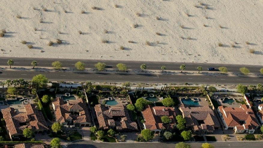 April 3, 2015: Homes with swimming pools border the desert of this neighborhood in Cathedral City, Calif. (AP Photo/Chris Carlson)