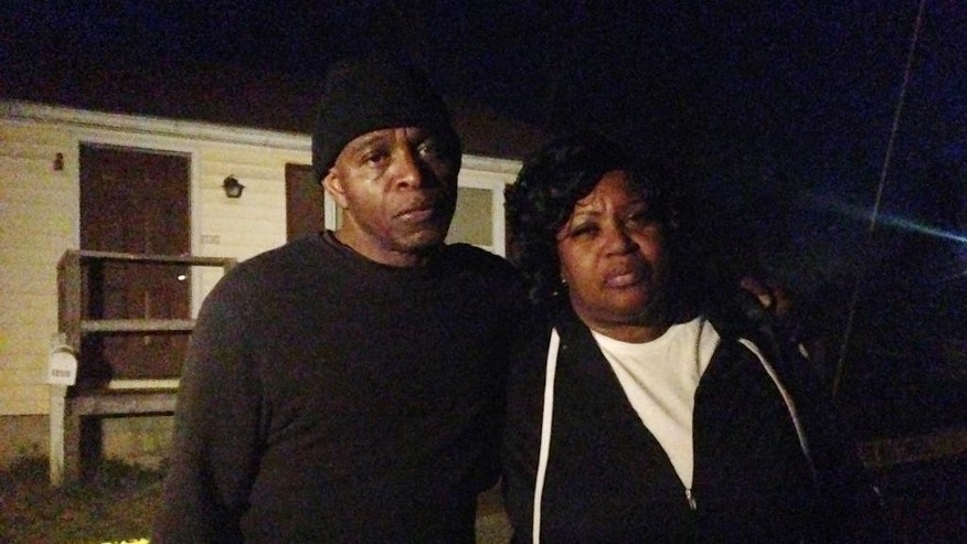 Lloyd Edwards, left, and Bonnie Edwards, the stepfather and mother of Rodney Todd stand outside the home where Todd and his seven children found dead Monday, April 6, 2015, in Princess Anne, Md. Police found the bodies at the home after being contacted by a concerned co-worker of the father, who had not been seen for days, Princess Anne police said in a news release. (AP Photo/Juliet Linderman)