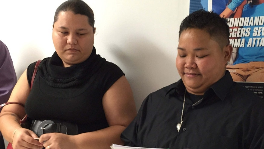April 8, 2015: Loretta M. Pangelinan, 28, holds the application for a marriage license that she and her fiancee, Kathleen M. Aguero, 28, will turn in at the Office of Vital Statistics in the Guam Department of Public Health and Social Services.