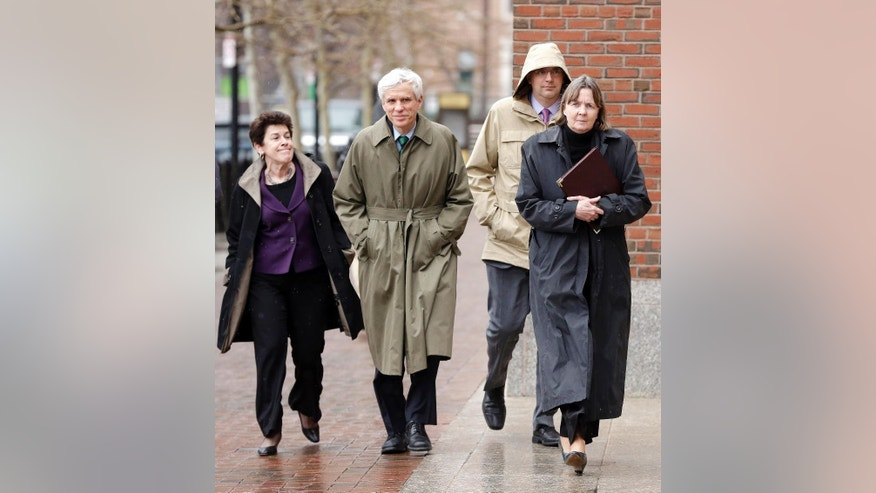 Members of the legal defense team for Boston Marathon bombing suspect Dzhokhar Tsarnaev, from the left, Miriam Conrad, David Bruck, William Fick and Judy Clarke, arrive at federal court, Tuesday, April 7, 2015, in Boston. A month after the trial began in the Boston Marathon bombing case, the jury began deliberations Tuesday. (AP Photo/Steven Senne)