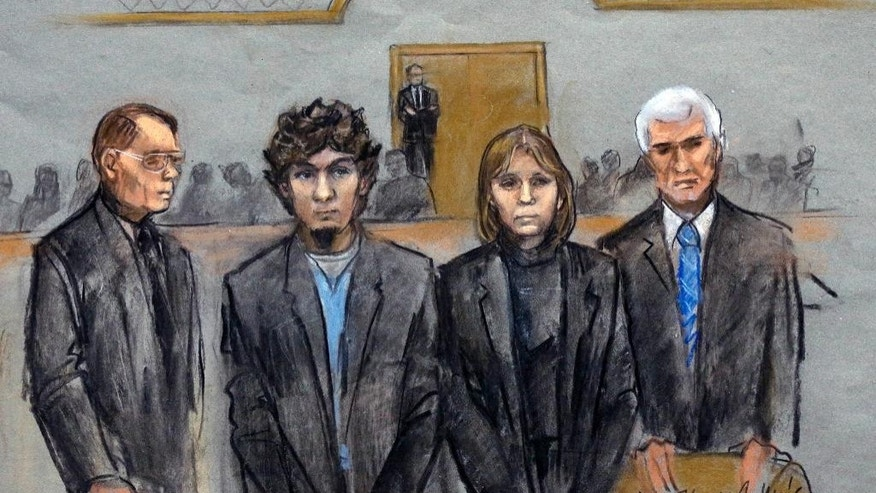 ADDS NAMES OF LAWYERS - In this courtroom sketch, Dzhokhar Tsarnaev, second from left, is depicted standing with his defense attorneys William Fick, left, Judy Clarke, second from right, and David Bruck, right, as the jury presents its verdict in his federal death penalty trial Wednesday, April 8, 2015, in Boston. Tsarnaev was convicted on multiple charges in the 2013 Boston Marathon bombing. Three people were killed and more than 260 were injured when twin pressure-cooker bombs exploded near the finish line. (AP Photo/Jane Flavell Collins)