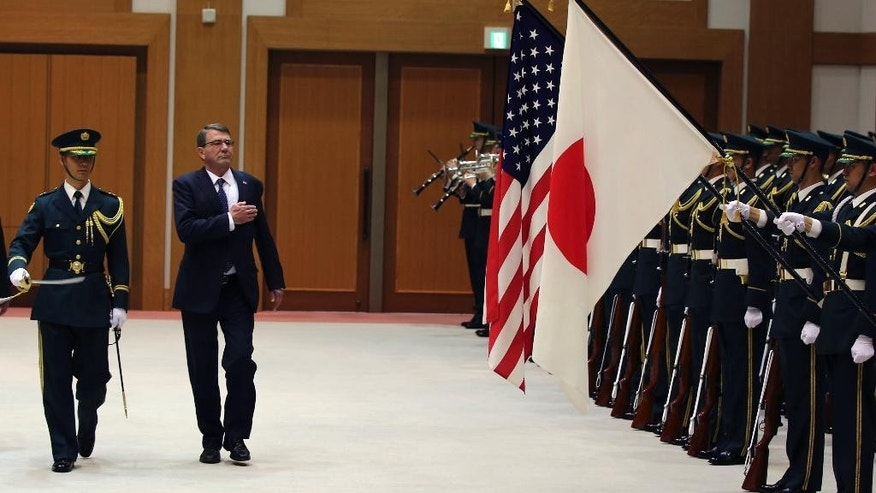 U.S. Defense Secretary Ash Carter, right, is escorted to inspect an honor guard at the Defense Ministry in Tokyo, Wednesday, April 8, 2015. Carter visits Japan and South Korea this week amid speculation the U.S. wants to place a missile defense system in South Korea against North Korean ballistic missiles, which Seoul is reluctant about as it would alienate China. The U.S. has already deployed anti-missile radar in Japan. (AP Photo/Eugene Hoshiko)