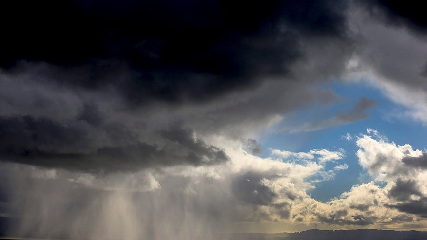 April 7, 2015: Storm clouds and rain move across the San Francisco Bay
