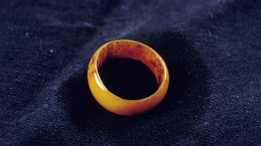 "This photo provided by the Smithsonian Institution's National Museum of American History on April 8, 2015 in conjunction with the upcoming book ""Shipwrecked in Paradise: Cleopatra's Barge in Hawaii,"" shows a vegetal ivory finger ring found in the wreckage of a ship belonging to King Kamehameha II, aka Liholiho, the second king of Hawaii, which sunk off the coast of Kauai, Hawaii in 1824. (AP Photo/Smithsonian Institution's National Museum of American History, Hugh Talman)"