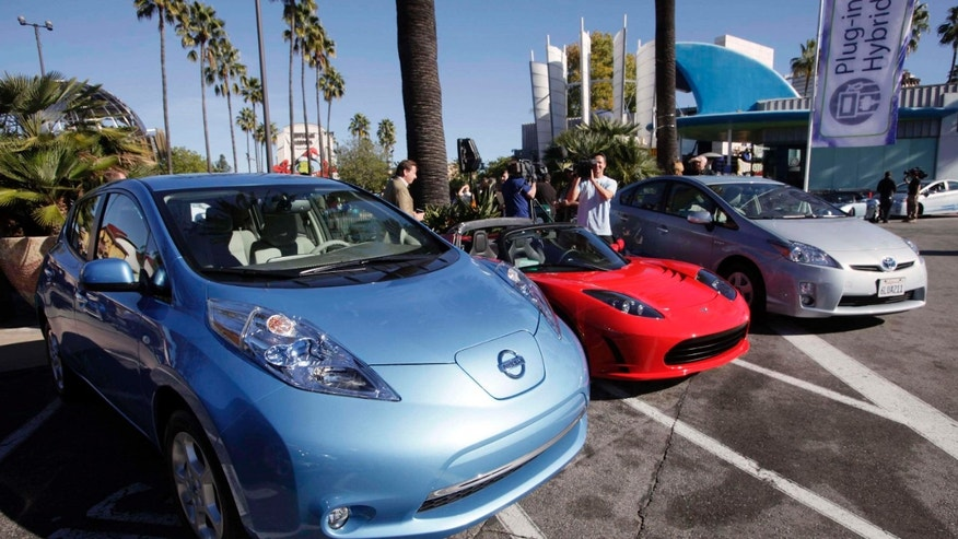 Dec. 13, 2013: File photo shows from left, electric cars from Nissan,Tesla, and Toyota presented at a news conference in Los Angeles.