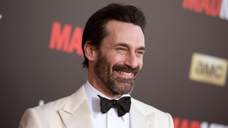 "FILE - In this March 25, 2015 file photo, Jon Hamm arrives at The Black And Red Ball In Celebration Of The Final Seven Episodes Of ""Mad Men"" in Los Angeles. Court records show ""Mad Men"" star Jon Hamm was accused of helping lead a violent 1990 fraternity hazing at the University of Texas. (AP Photo/Photo by Richard Shotwell/Invision/AP, File)"