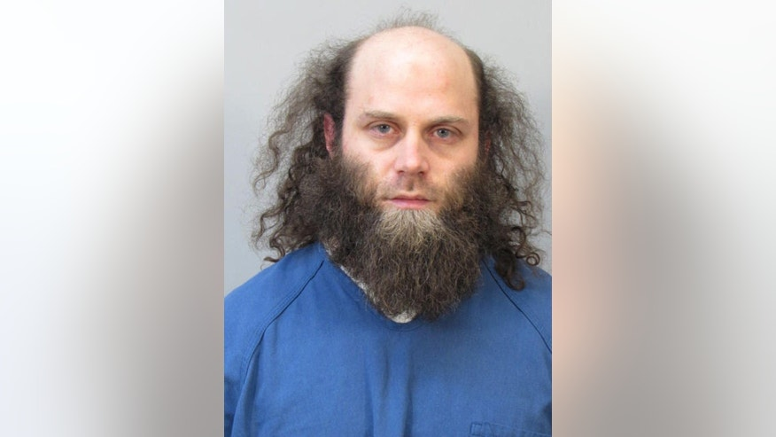 In this photo provided by the Dane County Sheriff's Offce, Joshua Van Haften, 34, appears as he is booked Wednesday, April 8, 2015, in Madison, Wisc. Van Haften, accused of traveling to Turkey as part of a failed attempt to join the Islamic State in Syria, was ordered held without bond Thursday for trying to aid a terrorist group. (AP Photo/Dane County Sheriff's Office)