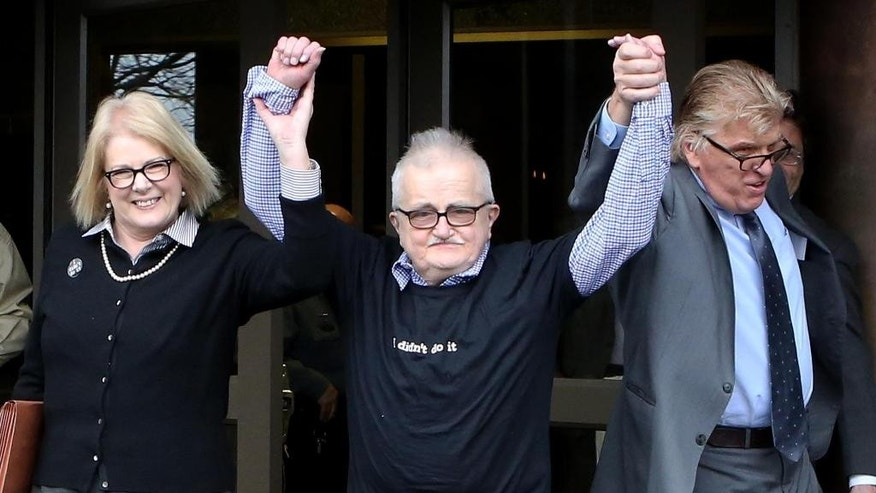 Richard Lapointe, center, raises his arms with Kate Germond, left, Centurion Ministries Co-Director, and Paul Casteleiro, right,  Centurion Ministries Legal Director, after he was granted bail and released at the Connecticut Supreme Court in Hartford Conn., on Friday April 10, 2015.  The mentally disabled convict was released following a court order for a redo of a murder trial that condemned him on the basis of a disputed confession. Lapointe was convicted in 1992 of killing Bernice Martin, who was found stabbed, raped and strangled in her burning Manchester apartment. A judge had sentenced him to life in prison without the possibility of release. (AP Photo/Journal Inquirer, Jared Ramsdell)   MANDATORY CREDIT