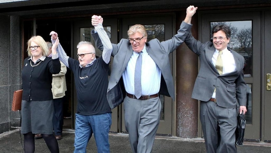 Richard Lapointe, second from left, raises his arms with Kate Germond, left, Centurion Ministries Co-Director, Paul Casteleiro  Centurion Ministries Legal Director, and Jim Cousins, Centurion Ministries Legal Associate, after he was granted bail and released at the Connecticut Supreme Court in Hartford Conn., on Friday April 10, 2015.  The mentally disabled convict was released following a court order for a redo of a murder trial that condemned him on the basis of a disputed confession. Lapointe was convicted in 1992 of killing Bernice Martin, who was found stabbed, raped and strangled in her burning Manchester apartment. A judge had sentenced him to life in prison without the possibility of release. (AP Photo/Journal Inquirer, Jared Ramsdell)   MANDATORY CREDIT