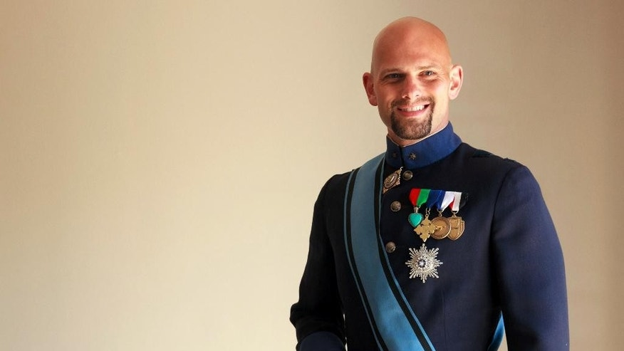 This April 8, 2015 photo shows His Royal Highness the Grand Duke of Westarctica, aka Travis McHenry, posing in his uniform in West Hollywood, Calif. McHenry will be among the largest gathering of world leaders this side of the United Nations, convening Saturday, April 11, 2015 at MicroCon 2015, what organizers say is the first North American gathering of micronations, those tiny little countries that pretty much nobody but the people who rule them believe really exist. No one will be representing the United States, Great Britain or China, but you may catch a glimpse of the president of Molossia, decked out in a beribboned, full-dress uniform that would be the envy of any Third World dictator, with kings, queens, dukes and barons from places like Slabovia, Westarctica, Vikesland and Broslavia. (AP Photol/Gabriela Alvarez)