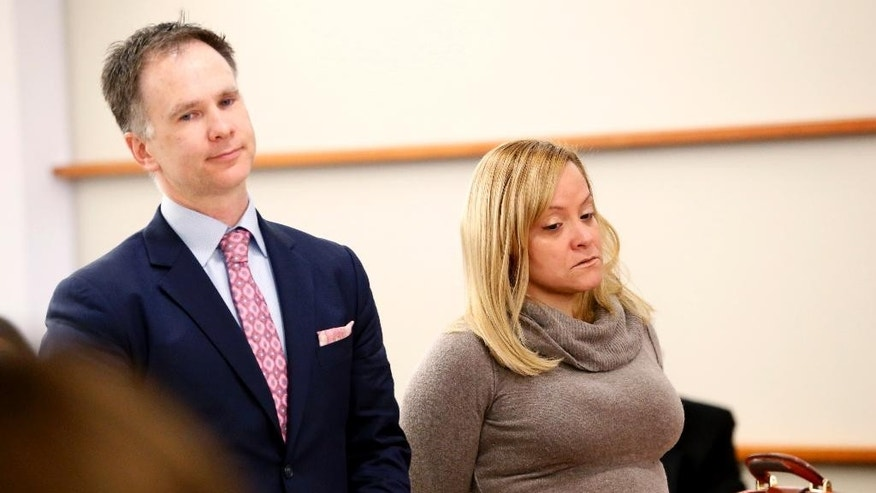 Liana Barrientos, right, appears in Judge Steven Barrett's courtroom at the Bronx Supreme Court during an arraignment, Friday, April 10, 2015, in New York. Barrientos is accused of marrying 10 times over an 11-year period without ever getting a divorce. The Bronx district attorney's office says she faces two counts of felony fraud charges. (AP Photo/Julio Cortez)