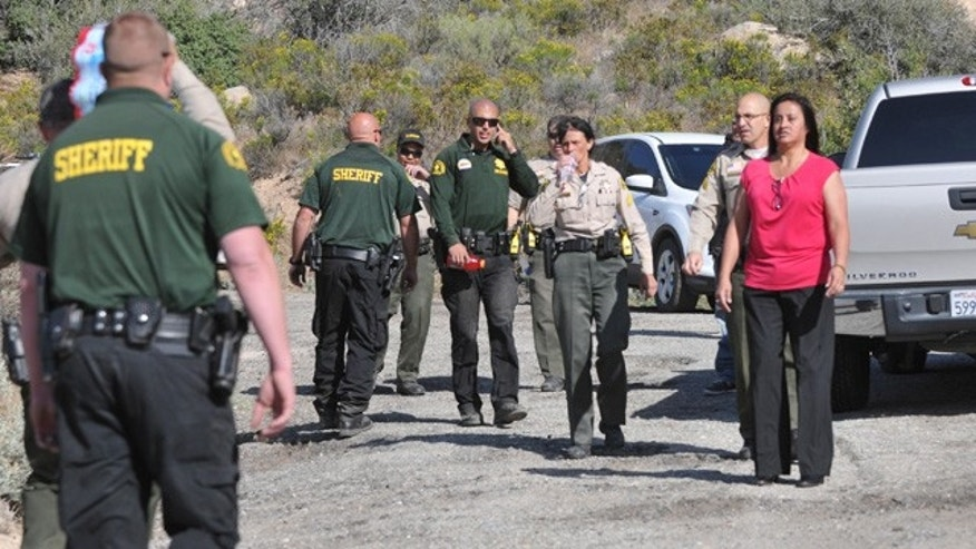 April 9, 2015: Law enforcement personnel search for a suspect who stole a horse and fled into the mountains near Deep Creek in Apple Valley, Calif. A Southern California sheriff on Thursday ordered an immediate investigation after deputies were recorded beating and kicking the suspect. (AP Photo/The Victor Valley Daily Press, David Pardo)