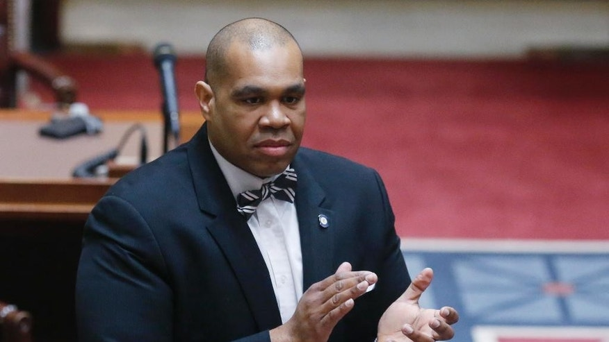 FILE - In this Monday, Feb. 3, 2014 file photo, former Oklahoma state Sen. Jabar Shumate, D-Tulsa, stands on the Senate floor in Oklahoma City. Shumate, the University of Oklahoma's new chief of diversity programs says he's right for the job after a racist video roiled the school last month. (AP Photo/Sue Ogrocki, File)