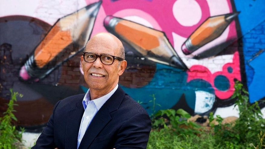 "FILE - In this June 5, 2014 file photo, Michael Lomax, president of the United Negro College Fund, poses for a portrait by a painted mural in Washington. The United Negro College Fund is perhaps best known for its slogan: ""A mind is a terrible thing to waste."" Lomax, isn't shy about ruffling feathers if it means raising money for a cause he passionately believes in, which is funding the nation's historically black colleges and universities and providing scholarships for low-income students. (AP Photo/Jacquelyn Martin, File)"