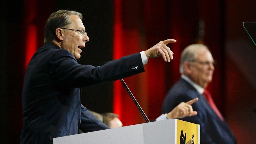Wayne LaPierre, left, executive vice president of the National Rifle Association, speaks during the annual meeting of members at the NRA convention Saturday, April 11, 2015, in Nashville, Tenn. At right is Jim Porter, NRA president. (AP Photo/Mark Humphrey)
