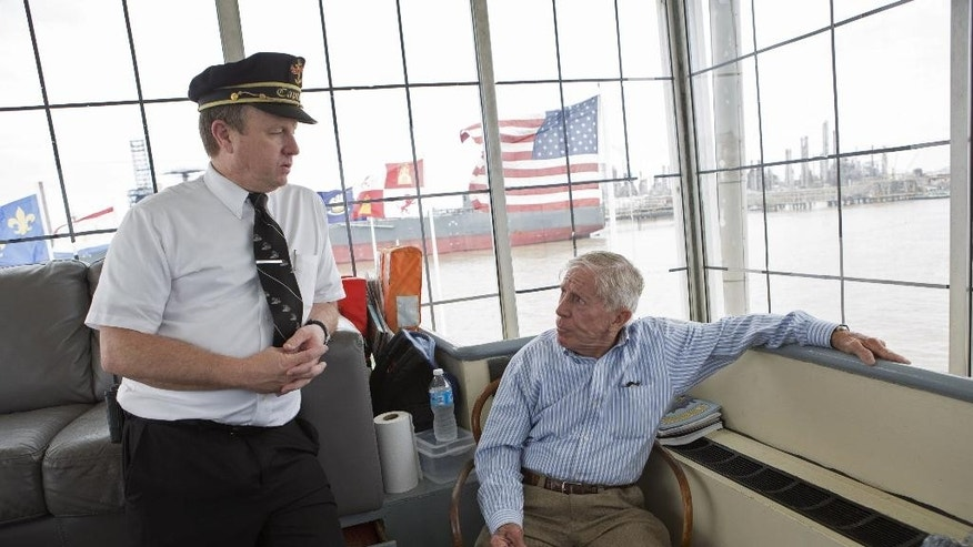 In a Sunday, March 15, 2015 photo, Captain Donald Houghton, left, and former captain Doc Hawley chat on the Natchez steamboat on the Mississippi River in New Orleans. The Natchez, which celebrates its 40th anniversary on Monday, April 13, is only one of three steam-powered boats left in the Mississippi River valley.  Hawley was there as the captain when the Natchez steamboat first launched its maiden voyage on April 13, 1975.  (AP Photo/Samantha Kaplan)