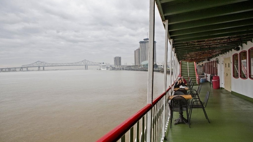 In a Sunday, March 15, 2015 photo, the Natchez steamboat is docked on the Mississippi River in New Orleans. The Natchez, which celebrates its 40th anniversary on Monday, April 13, is only one of three steam-powered boats left in the Mississippi River valley.  (AP Photo/Samantha Kaplan)