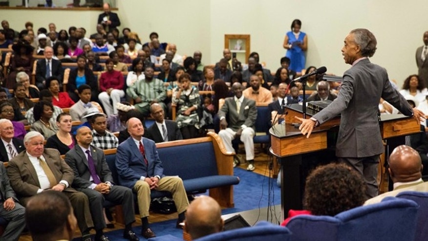 April 12, 2015: The Rev. Al Sharpton, right, speaks during a service at Charity Missionary Baptist Church in the wake of the death of Walter Scott, the black driver who was fatally shot by a white police officer after he fled a traffic stop, in North Charleston, S.C.