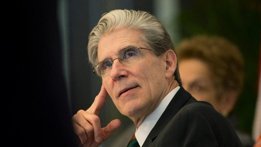 Dr. Julio Frenk, the dean of Harvard' school of public health and former Mexican Cabinet member, waits to speak at a press conference where he was named as the new president of the University of Miami in Coral Gables, Fla., Monday, April 13, 2015. He will become the first Hispanic to lead UM, and will formally become the replacement for outgoing President Donna Shalala on Sept. 1. (AP Photo/J Pat Carter)