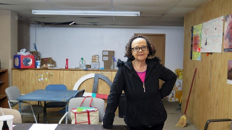 In this March 26, 2015 photo, Yvonne DeCory, a suicide-prevention outreach worker, stands in her small office in the basement of the Post Office in Pine Ridge, S.D. Nearly 1,000 suicide attempts were recorded on the reservation between 2004 and 2013. DeCory said few weeks go by with a suicide. (AP Photo/Regina Garcia Cano)